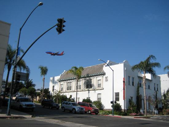 Plane landing, view from across the road. Hotel Occidental is the white building