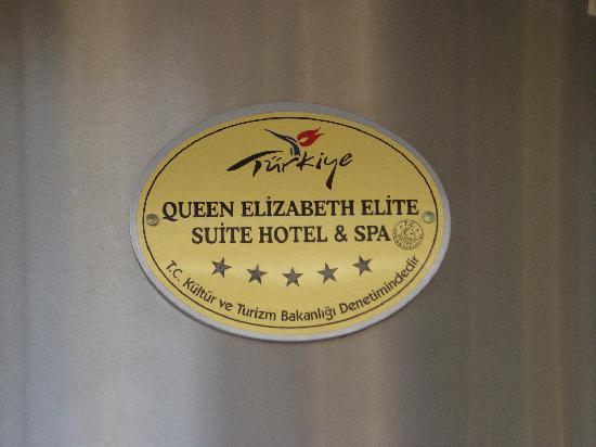 Queen Elizabeth Elite Suite Hotel & Spa: The hotel badge over front door