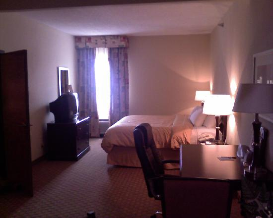 "Comfort Suites East: Bed, TV opposite the tables and the first ""bedroom"""