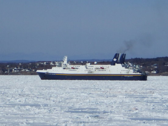 Cape Breton Island, Canada: Newfounland Ferry stuck in ice in Sydney Harbour.