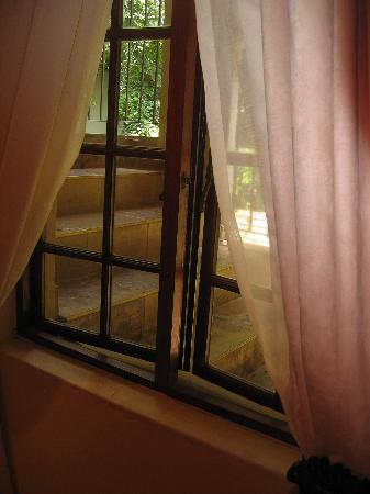 FernIvy Guest House : window of room next to stairs