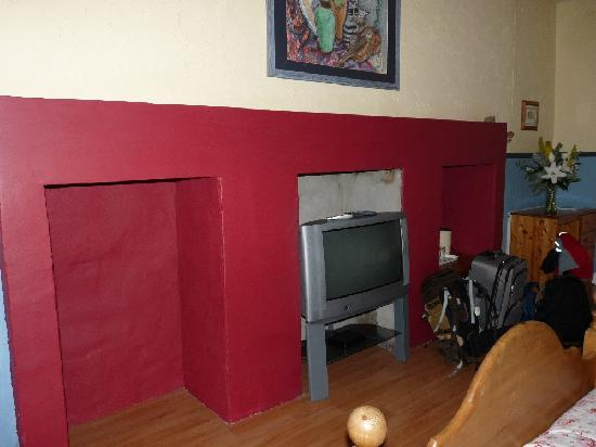 Dene Guest House: family room in basement