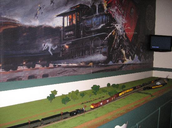 Casey Jones Village: Diorama of the accident below a large painting of the wreck.
