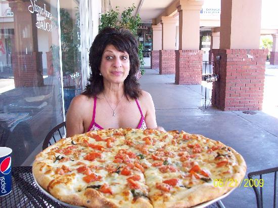 """Mamma Mia Brick Oven Pizza: medium margarita pizza 16"""" $14.95"""