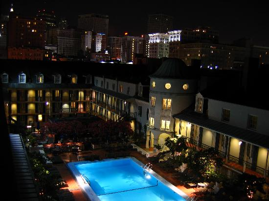 A Night View Of The Pool And Patio Area As Viewed From The R Club