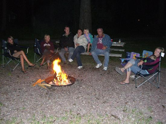 sitting around the fire pit picture of tamaracks resort seeley