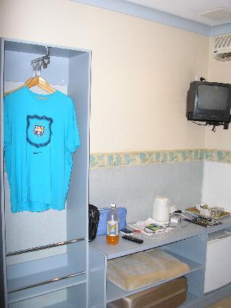 Hotel 59: Small desk and wardrobe
