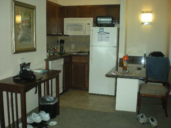 Staybridge Suites San Antonio NW near Six Flags Fiesta Texas: kitchen-dw/ref, micro, eating bar, cookware, plates, etc.
