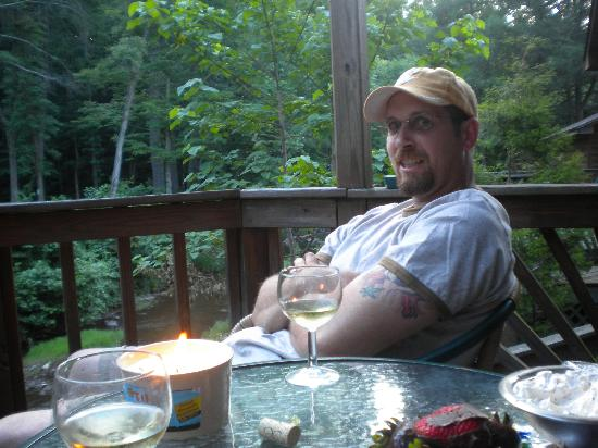 Brookside Cabins: Jon relaxing on the back deck.