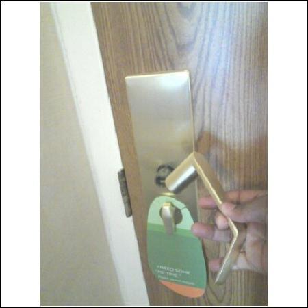 Courtyard Birmingham Homewood: door handle in hand