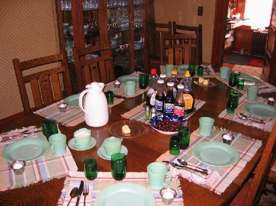 Alaska's Capital Inn Bed and Breakfast: breakfast table set with antique dishes