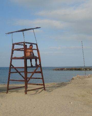 Gran Sol: very small man in high chair on beach