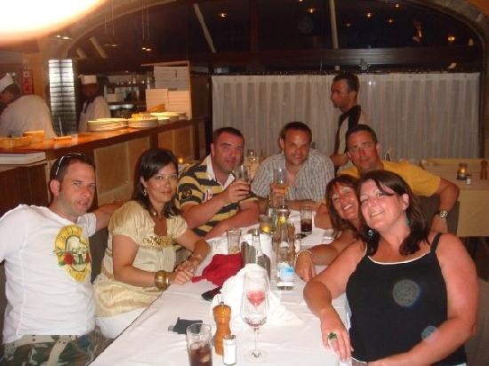 Pizzeria Pepa: Us having fun, taken by our waiter, complete with the ever -smiling chef in the top left:-)