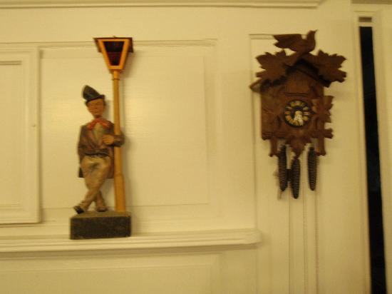 Musical Wonder House: A whistler stands next to a Black Forest cuckoo/musical clock.