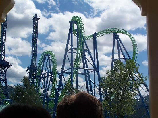 Silverwood Theme Park: A photo of Aftershock. You get pulled up the left tower, you fly through the cobra roll and loop