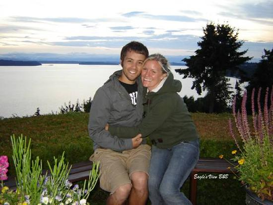 Eagle's View Bed and Breakfast, LLC: Here is my wife and I at Eagles View.  The view behind us is only a tenth of what you can see.