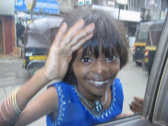 Hyatt Regency Mumbai: This girl found me EVERY time my driver slowed down at this intersection.  Guess I'm a sucker, s
