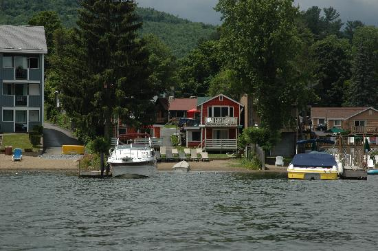 O'Sullivan's On The Lake Motel: View of OSullivan beach from Row Boat..immediately in front of the red cabin only