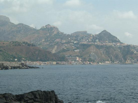 Taormina, Italy: gardina naxos with castemola high on hill