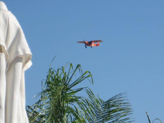 Pefkos Blue: Little aeroplane for tourists flying over pool