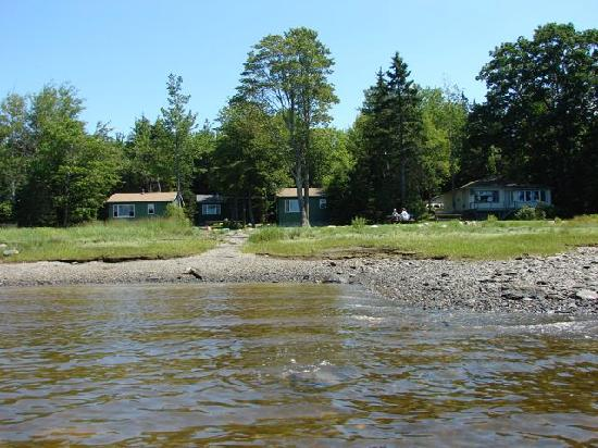 Windward Cottages: picture of the cottages from the bay