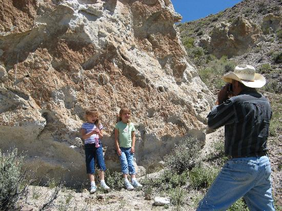 Wild Horse Safaris: Here our host has lined our granddaughters up against the rocks and shoots them (see the petrogl