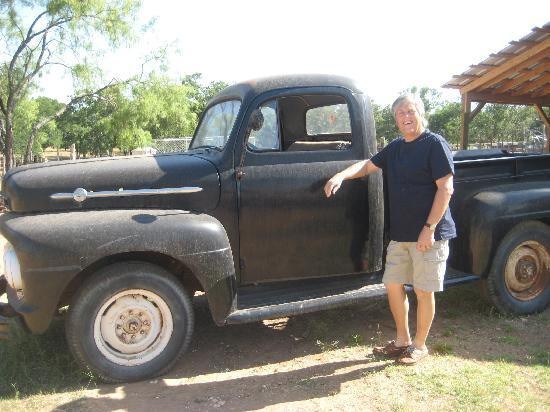 The Bunkhouse Bed and Breakfast: Ole standing by an old truck..