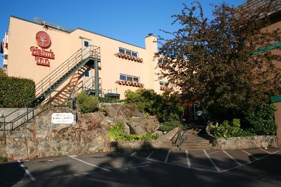 Helm's Inn: Exterior of motel with patio and rock garden with waterfall