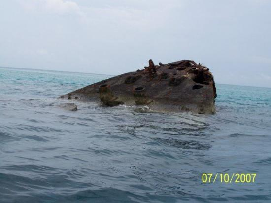 this is part of a shipwreck, still sticking out of the water. . .in the Bermuda triangle