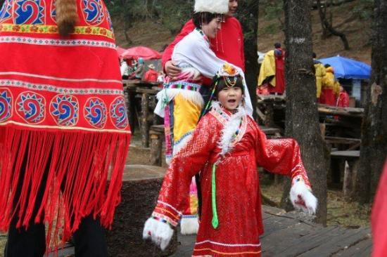 Yulong (Jade Dragon) Mountain: The locals will rent you a costume to take picutres.  This is one of the cute tourists.