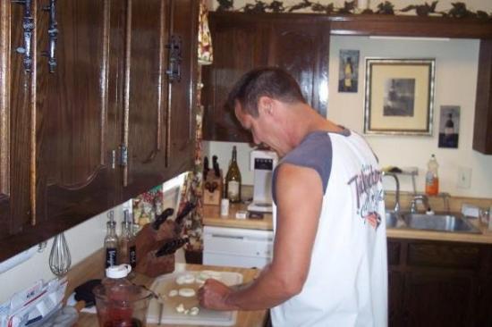 Sedalia, MO: my friend TJ dicing up the garlic.. he's good.