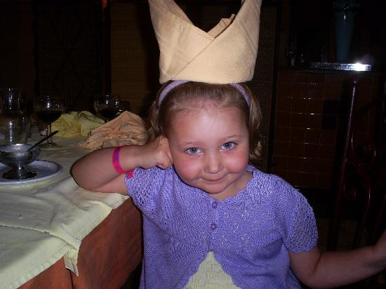 Chich Khan: my girl with her napkin crown made by the staff