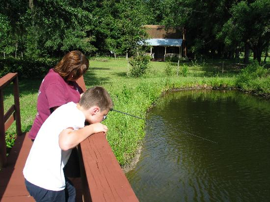 The Smoakhouse Ranch: Nephew and sister on the bridge crossing the fishing pond.  A lovely Cracker cottage in the back
