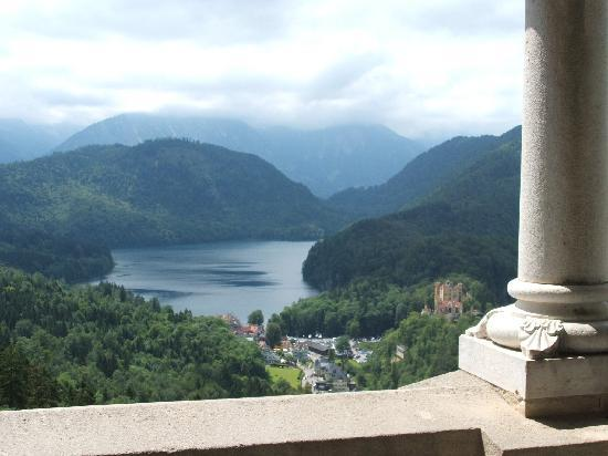 view of mountains, lake and Hohenschwangau Castle from inside Neuschwanstein castle