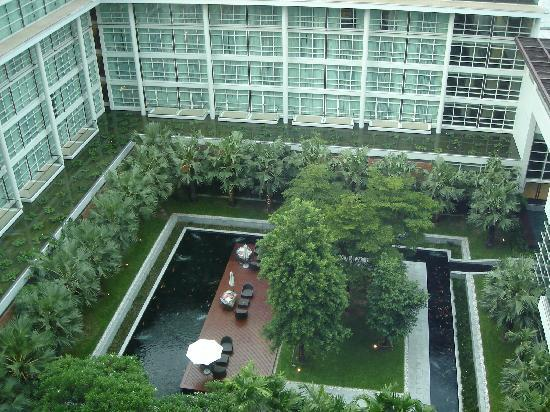 Garden and Koi Fish pond area in the middle of the hotel Picture