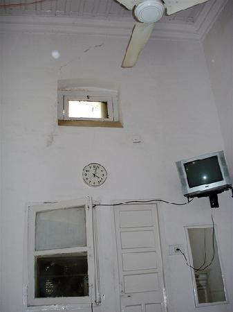Tourist Guest House: the only window in our room ... but the tv as another window