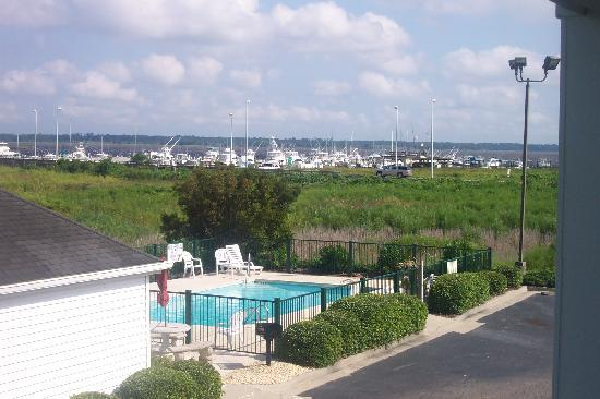 Baymont by Wyndham Georgetown/Near Georgetown Marina: View from hotel balcony of the pool & fitness ctr. along Winyah Bay