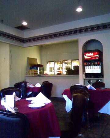 M & M Italian Restaurant: A view of basically the middle of the main room or dining area.