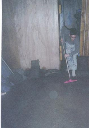 ‪النجف, العراق: during the raining season in iraq...i was sweeping water out of my room‬