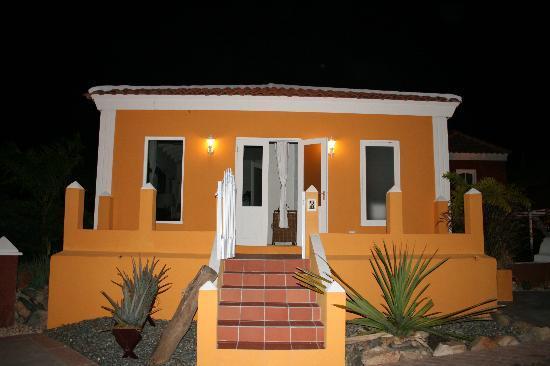 Cunucu Arubiano: Yellow villa at night.  Carl Lambert - Virginia