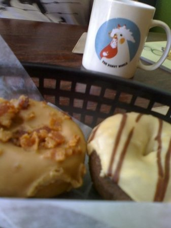 The Donut Whole: Maple Bacon on the left.  Peanut Butter Chocolate on the right.  Donut Whole coffee mug in bg