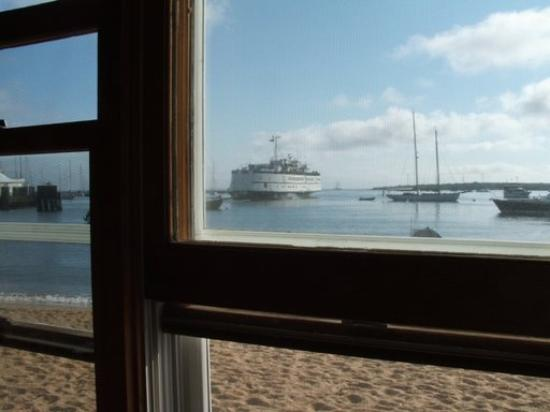 The ferry leaving Vineyard Haven from the Black Dog Tavern window.  Nice!