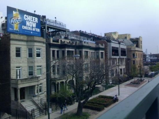 Apartments across the street from Wrigley field. They all have ...