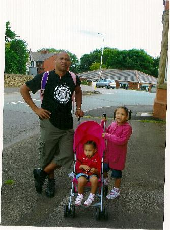 Wigan, UK: Waiting for a taxi with Uusha, 2 and Matilda, 5, next to the side entrance of Coaching Inn hotel