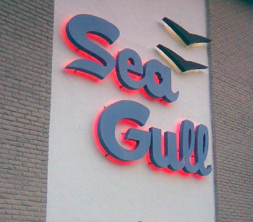 SeaGull Motel: A photo of the front sign at dusk.
