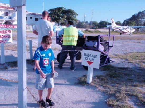 Ambergris Caye, Belize: Note the baggage claim, dirt runway!! Too cool!