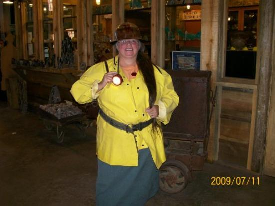 Queen Mine Tours: Mom in her mining gear. We all had to wear a vinyl jacket, a belt to hold the battery pack for t