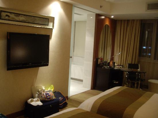 Gehua New Century Hotel: Habitación