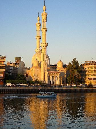 The Nile eases past Damietta at sunset