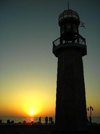 Damietta, Egypt: Sunrise on the Mediterranean Sea paints the lighthouse at Ras El Bar where the Nile meets the Me